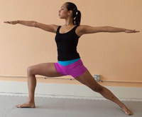 woman doing warrior pose in Kalon yoga shorts
