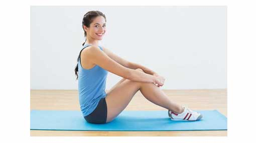 woman with shoes on yoga mat